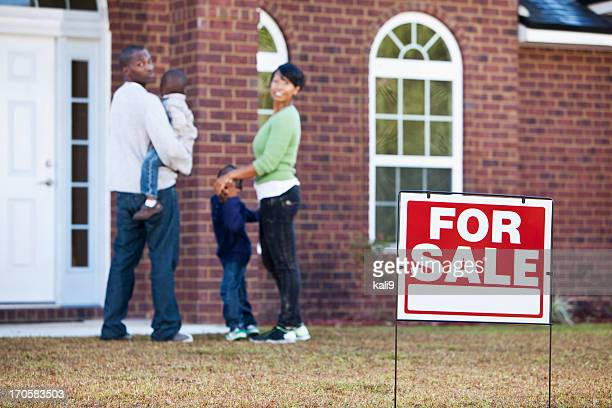 African American family looking at house for sale