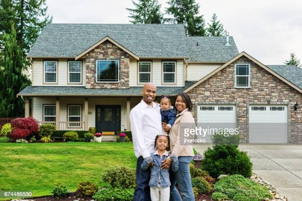 African American Family of Four at Home