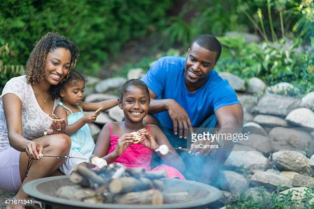african american family - fire pit stock pictures, royalty-free photos & images