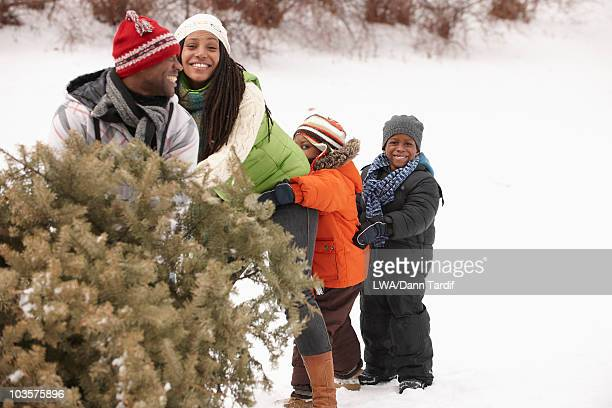 African American family retrieving Christmas tree