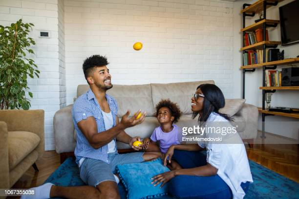 african american family spending time together at home - juggling stock pictures, royalty-free photos & images