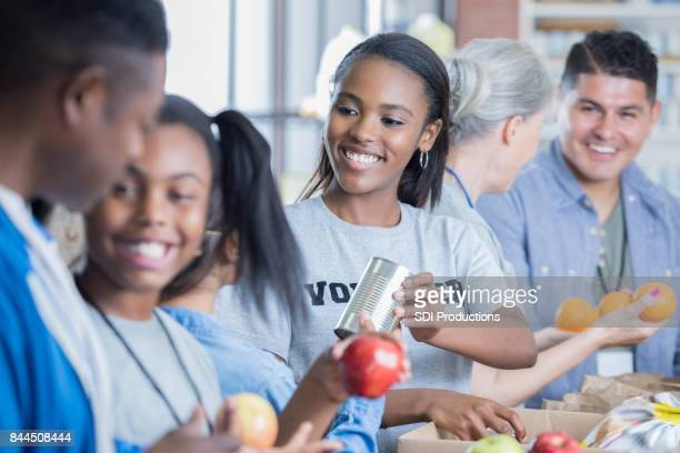 African American family volunteer during food drive