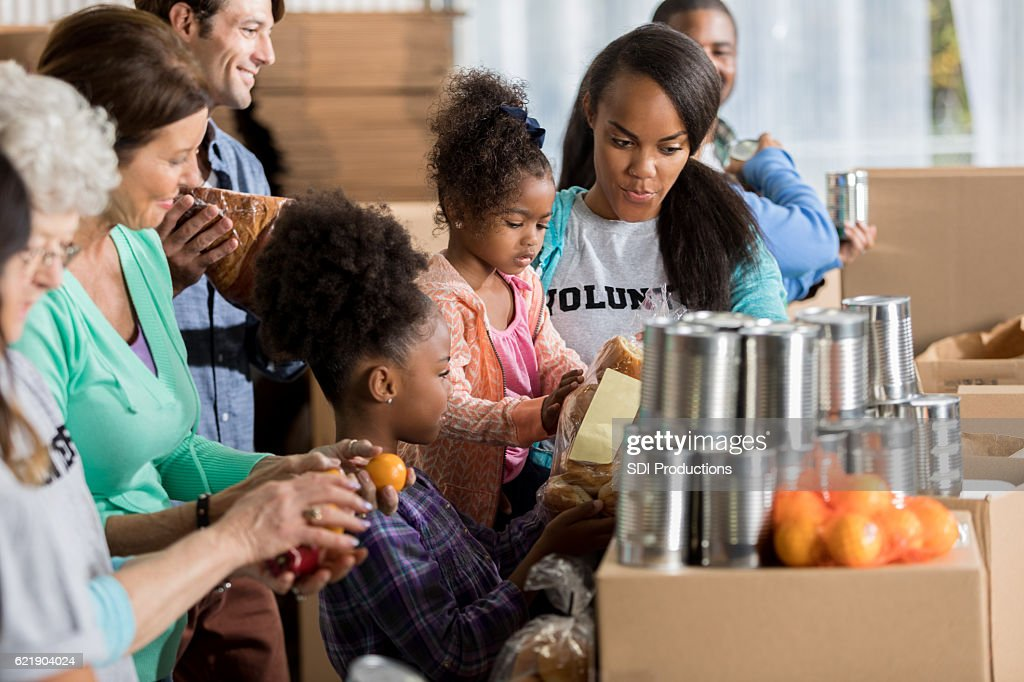 African American family volunteers during food drive : Stock Photo