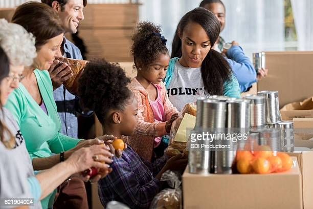 African American family volunteers during food drive