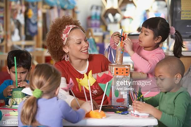 african american female art teacher with young students - art and craft product stock pictures, royalty-free photos & images