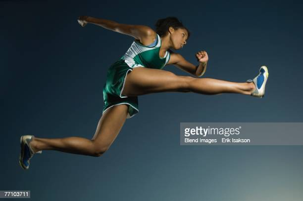 African American female athlete jumping