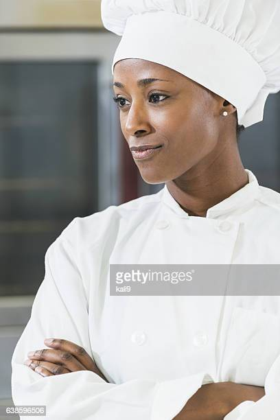 African American female chef in commercial kitchen