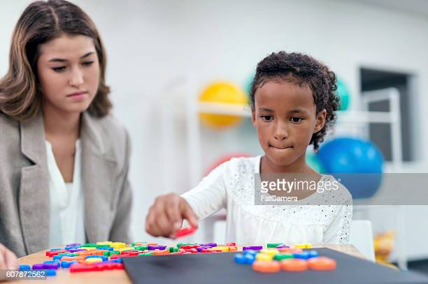 African american female child doing a puzzle exercise