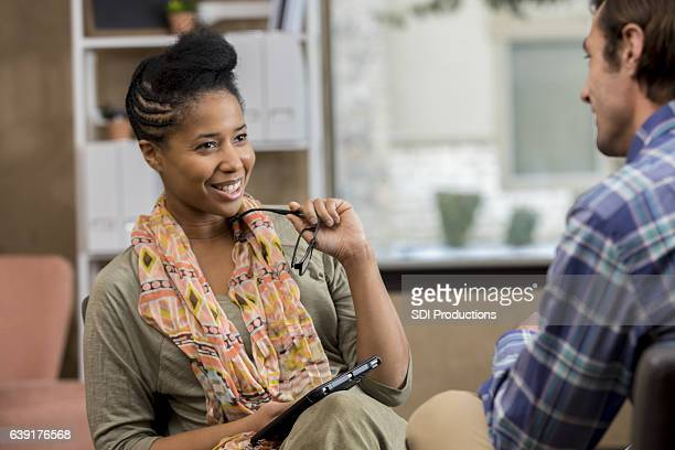 African American female counselor meets with client