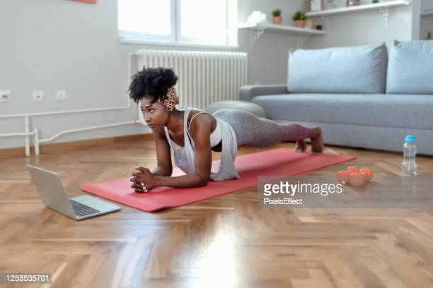 african american female in sportswear doing plank exercises - plank position stock pictures, royalty-free photos & images