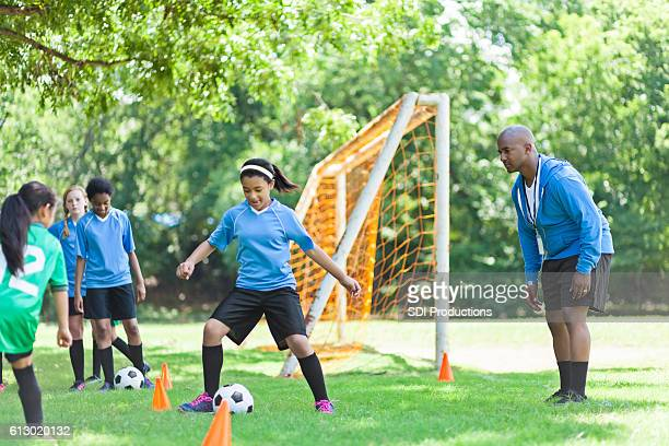 African American female soccer player during practice