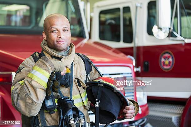 african american fireman at fire station - firefighter stock pictures, royalty-free photos & images
