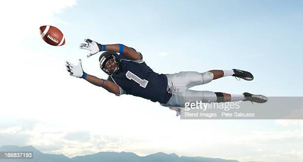african american football player catching ball - high school football stock pictures, royalty-free photos & images