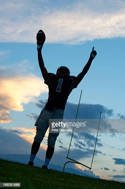 african american football player cheering in game - safety american football player stock pictures, royalty-free photos & images