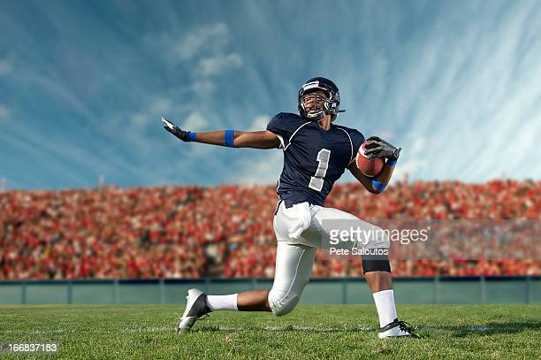 african american football player poised on field - safety american football player stock pictures, royalty-free photos & images
