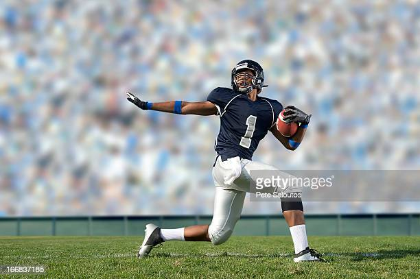 african american football player poised on field - rush american football stock pictures, royalty-free photos & images