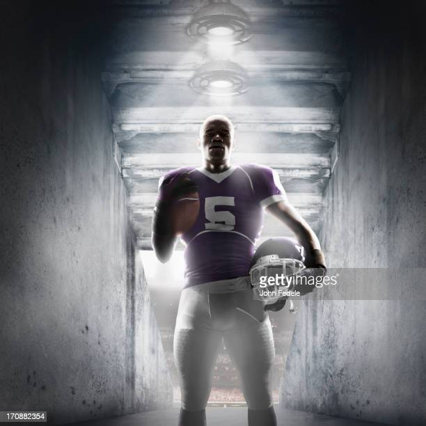 african american football player standing in hallway - safety american football player stock pictures, royalty-free photos & images
