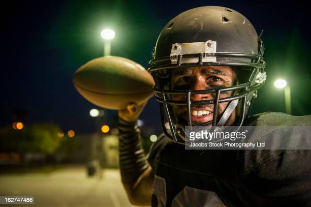 african american football player throwing the ball - quarterback stock pictures, royalty-free photos & images
