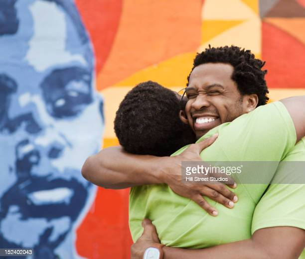 African American friends hugging