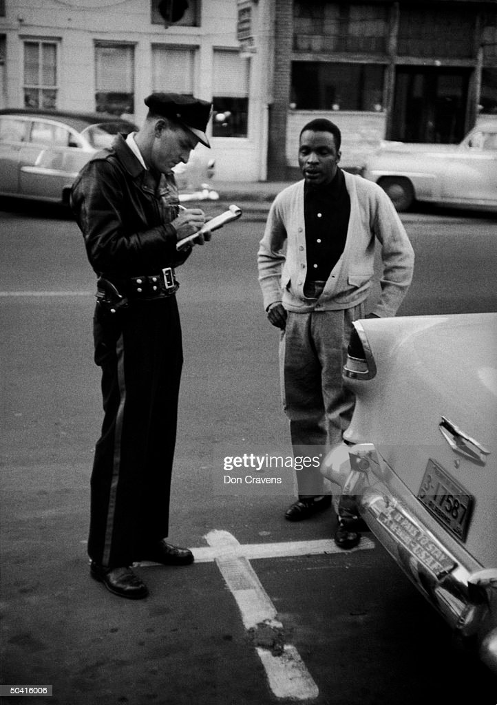 African American getting parking ticket, : News Photo
