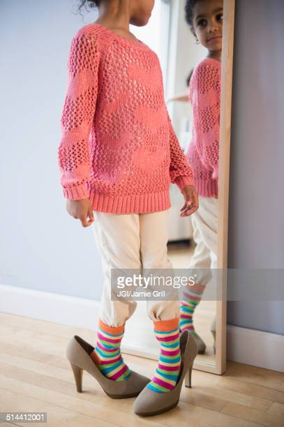 african american girl dressing up in mother's shoes - little girl in high heels stock photos and pictures