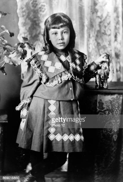 African American girl fulllength portrait standing next to table facing front From Types of American Negroes compiled and prepared by WEB Du Bois