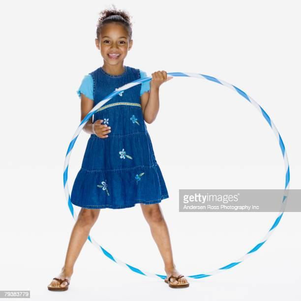 African American girl holding hula hoop
