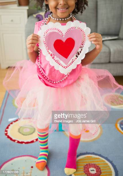 african american girl holding valentine's day card - valentines african american stock pictures, royalty-free photos & images