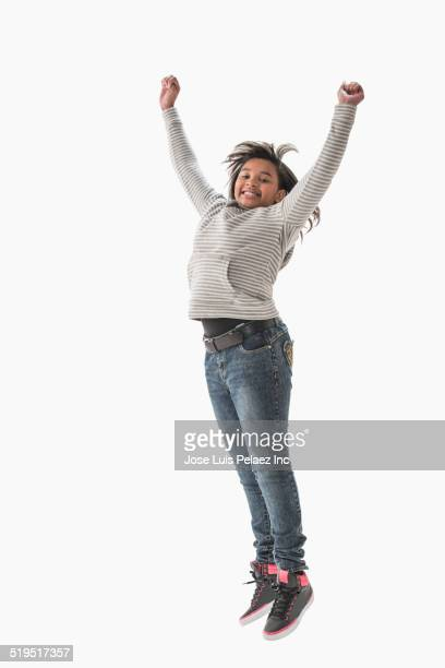 African American girl jumping for joy