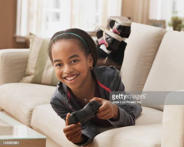 African American girl playing video game