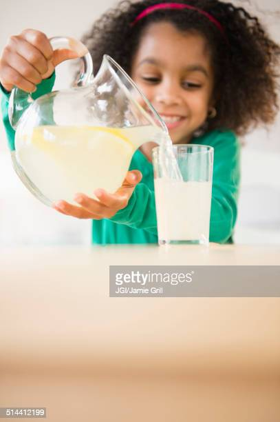 african american girl pouring glass of lemonade - lemon soda stock pictures, royalty-free photos & images