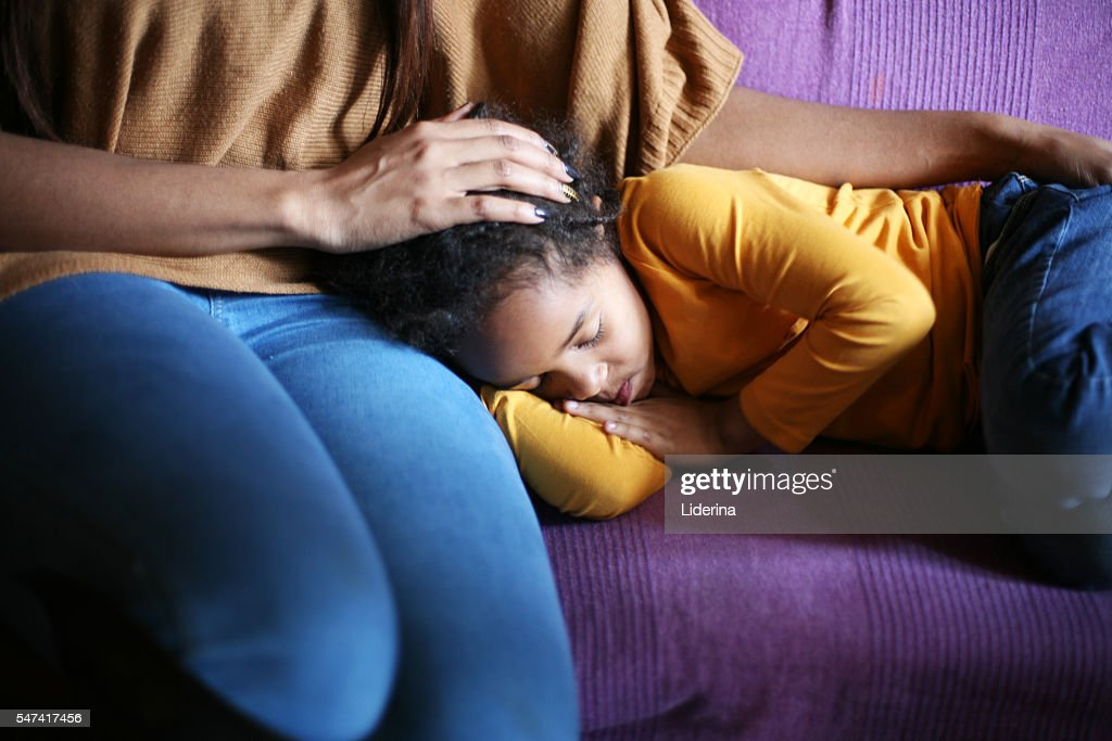 African American girl sleeping in mother lap. : Stock Photo