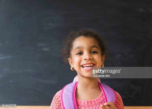 African American girl smiling in classroom