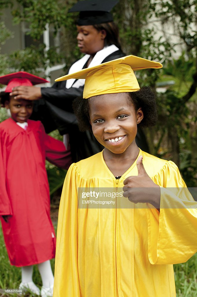 African American Girl With Cap And Gown Stock Photo | Getty Images