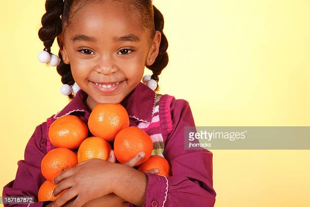 african american girl with oranges - girl mound stock pictures, royalty-free photos & images