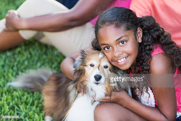 African American girl with pet dog