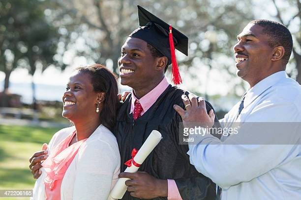 african american graduate with proud parents - graduation crowd stock pictures, royalty-free photos & images