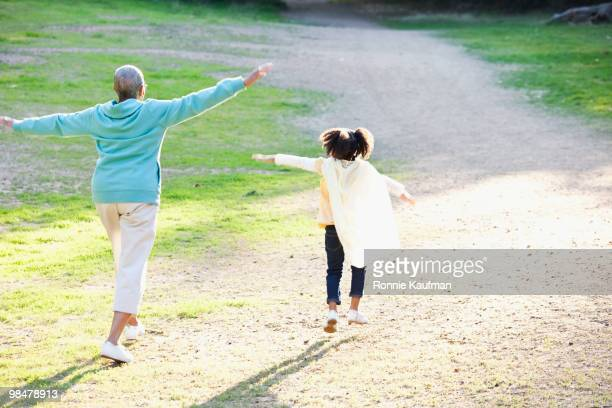 African American grandmother and granddaughter playing together