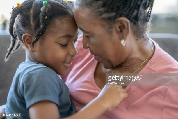 african american grandmother with her granddaughter - showus stock pictures, royalty-free photos & images