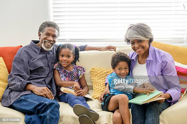 African American grandparents with grandchildren on sofa
