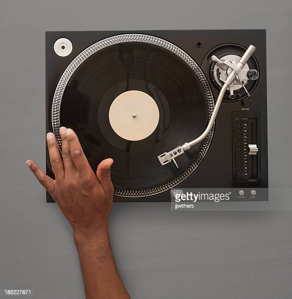 African American Hand spinning record on turn table