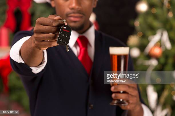 African American handing over car keys while drinking
