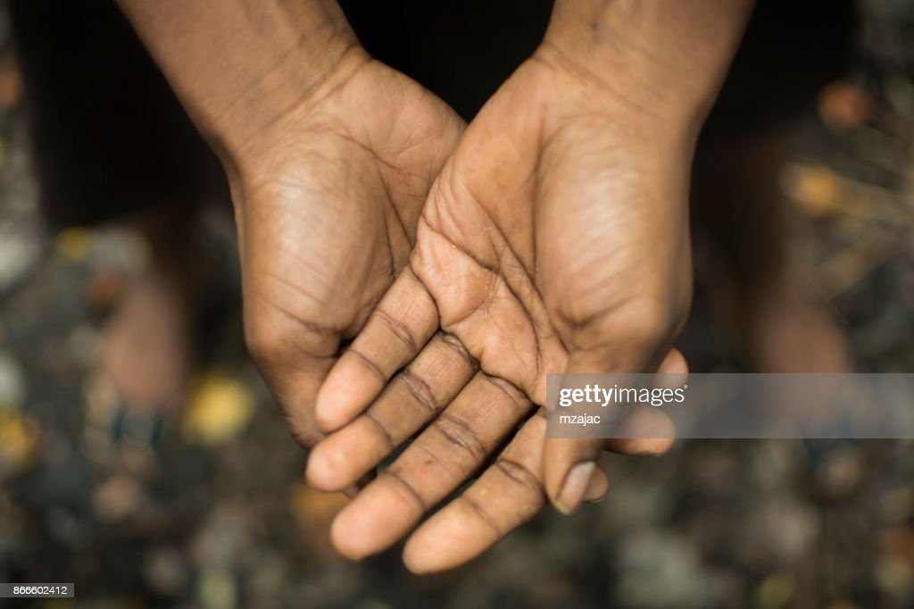 African American hands held together : Stock Photo