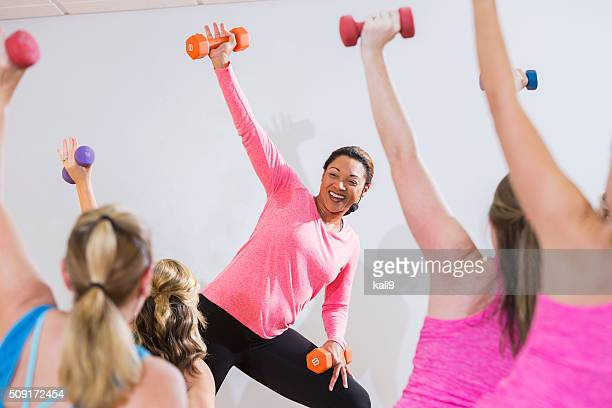 African American instructor leading aerobics class