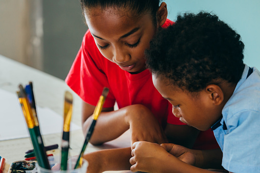 African American kids drawing and painting 1153255882