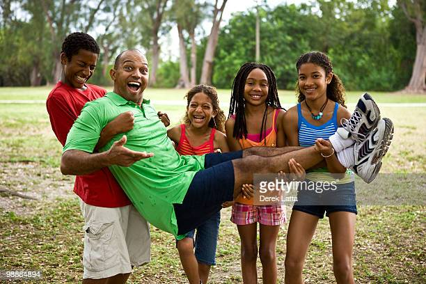 African American Kids holding up Dad