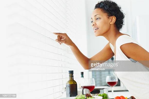 African American lady looking through blinds