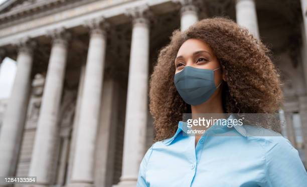 african american lawyer wearing a facemask outside a court - lawyer stock pictures, royalty-free photos & images