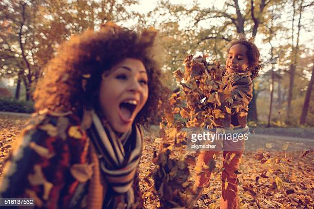 African American little girl and mother having fun in nature.