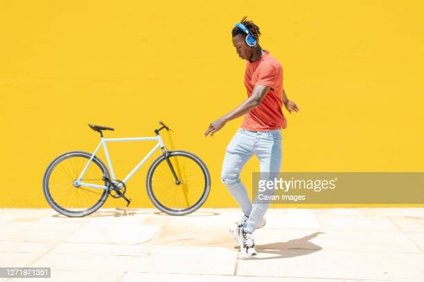 african american male dancing on street - dancing stock pictures, royalty-free photos & images